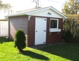 Brown Siding with Board and Batten on Shed