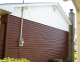 Brown Siding with White Board and Batten and Gable Vent