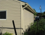 rear-of-garage-after-siding-window-and-eaves-small