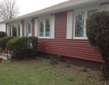 Rustic Red Siding Eaves Fascia and Soffit