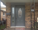outside-view-of-queenston-series-steel-door-with-venting-sidelite