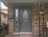 outside-view-of-queenston-series-steel-door-with-venting-sidelite