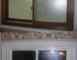 Bathroom Window With vinyl Casing and Rosettes Before and After